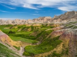 A lush color-filled valley at the base of jagged formations makes for my favorite viewpoint in the Badlands
