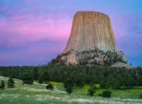 When sunset was over the last glow of dusk lended lovely color to clouds behind Devils Tower