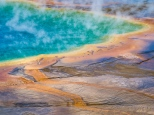 Steam rises off the rainbow-colored cGrand Prismatic Spring evoke an alien landscape
