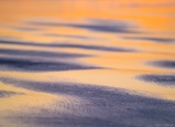 Sunset light plays off wet sand in an abstract interpretation of Oregon coastal glory