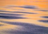 Sunset light plays off wet sand in an abstract interpretation of Oregon coastal glory