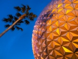 The enormous Spaceship Earth glows in the light of dusk at Epcot