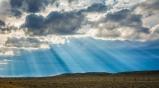 Shafts of sunlight break through storm clouds in rural Wyoming