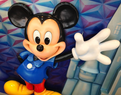Passengers arriving at the Orlando airport are greeted by a Mickey Mouse statue