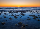 Dusk falls over the Gulf of Mexico at low tide near the coastal town of Dunedin, FL