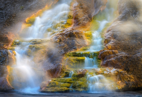 An atmosphere of mystery swirls around a thermal hot springs at Yellowstone National Park