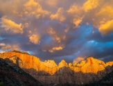 An October sunrise brings glorious life to the Towers of the Virgin in Zion National Park